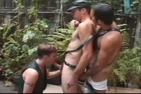 Latex Wearing males In threesome