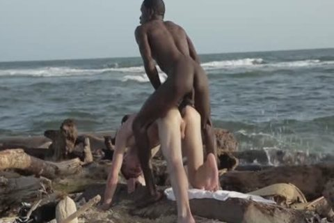 Hung Interracial bare On The Beach