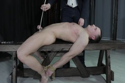 sexy lad tied Down, Balls Strung Up And Spanked