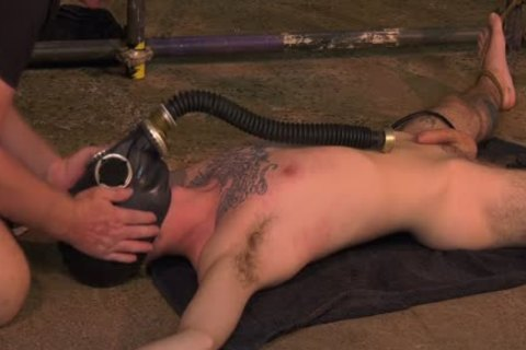Roped Down twink gets A Gas Mask And A rough handjob